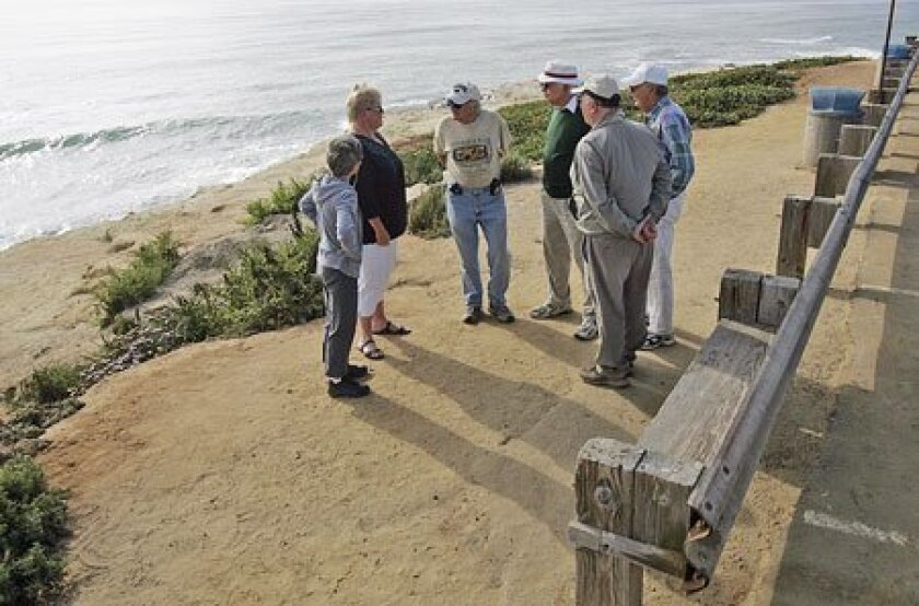 Sunset Cliffs regulars (from left) Sue Hogue, Susan Reed, Joel Siegfried, Ivan Sedrel, Duane Ellis and  Reinhold Noor discussed their quest to have the benches returned. (Sean M. Haffey/ Union-Tribune)