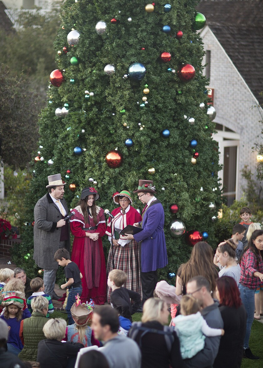 The Tinseltown Carolers perform at a previous Santa by the Sea event in Del Mar.