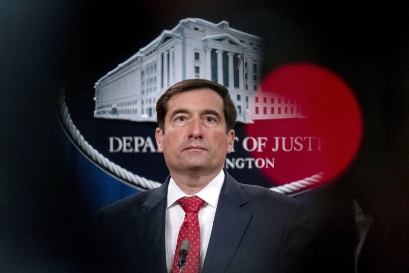 In this Oct. 19, 2020 file photo, Assistant Attorney General for the National Security Division John Demers takes a question from a reporter via teleconference at a news conference at the Department of Justice in Washington. The Trump administration says it plans to use proceeds from the sale of fuel confiscated from Iranian tankers to benefit victims of terrorism. The U.S. government in August seized 1.1 million barrels of fuel from four Iranian tankers bound for Venezuela. The fuel has since been sold, and officials say the proceeds will go to a special fund for victims of state-sponsored terrorism. A separate forfeiture complaint from the Justice Department centers on Iranian missiles that were seized from flagless vessels last November and last February. Officials say the cargo was intended for militant groups in Yemen. (AP Photo/Andrew Harnik, pool)