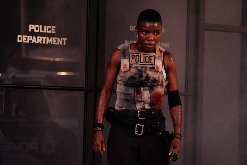 """A battle-scarred policewoman in the movie """"Copshop."""""""