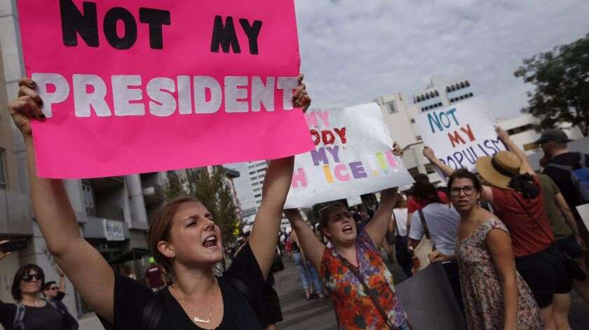 Protesters in Los Angeles express their disapproval with the election of Donald Trump as the next U.S. President in Los Angeles on Nov. 12.