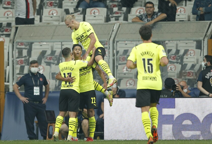 Dortmund players celebrate after Dortmund's Jude Bellingham scored his side's opening goal during the Champions League Group C soccer match between Besiktas and Borussia Dortmund at the Vodafone Park Stadium in Istanbul, Turkey, Wednesday, Sept. 15, 2021. (AP Photo)