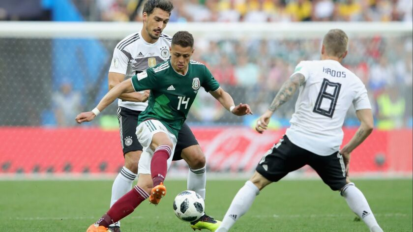 Mats Hummels of Germany battles for the ball with Javier Hernandez of Mexico during the 2018 FIFA World Cup Russia group F match between Germany and Mexico at Luzhniki Stadium.