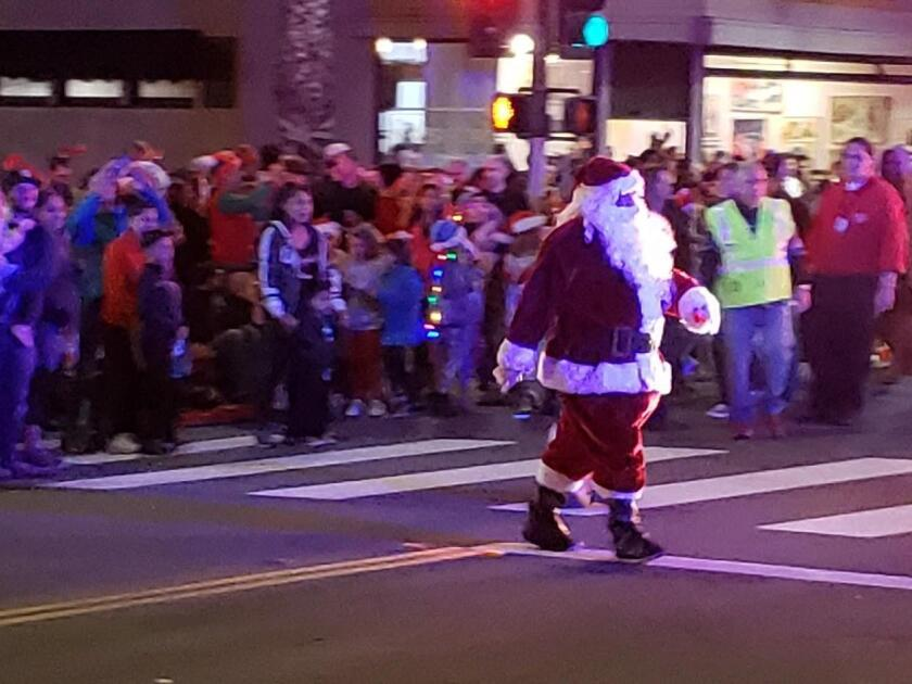 Santa Claus makes his way over the the broadcast booth.