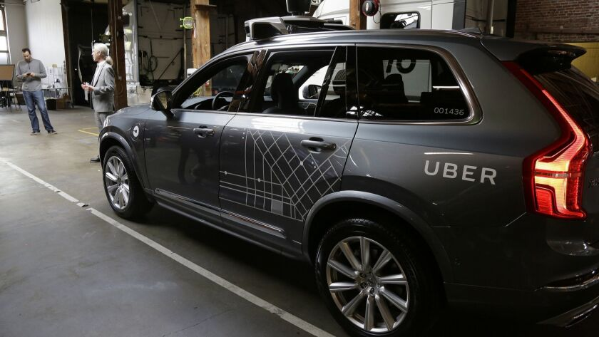FILE - In this Dec. 13, 2016 file photo, an Uber driverless car is displayed in a garage in San Fra