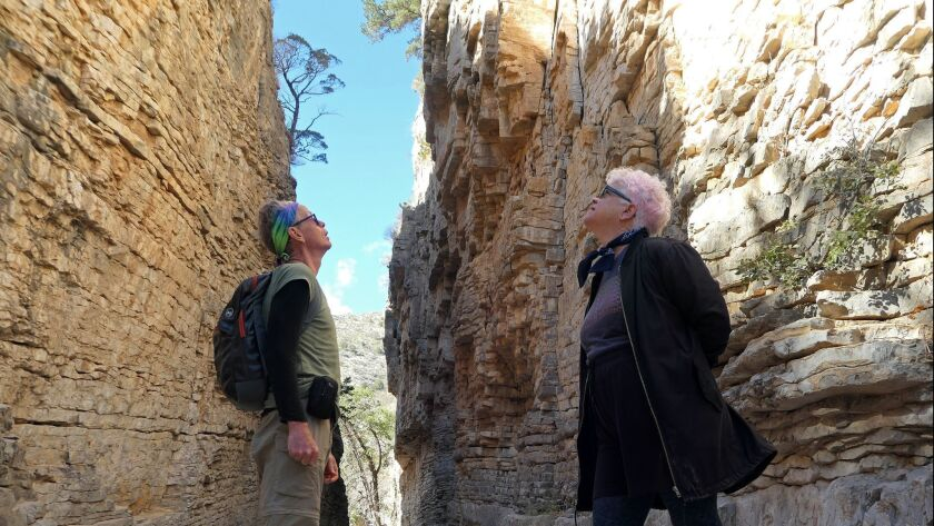 John Nelson and wife Leslie Kelly look into the Devil's Hall slot canyon at Guadalupe Mountains Nati