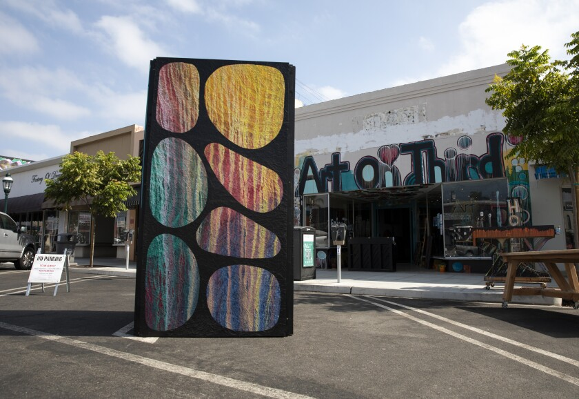 Rich Walker, owner of Art On Third, said he kept his parklet simple with a sculpture during PARK (ing) Day in Chula Vista.