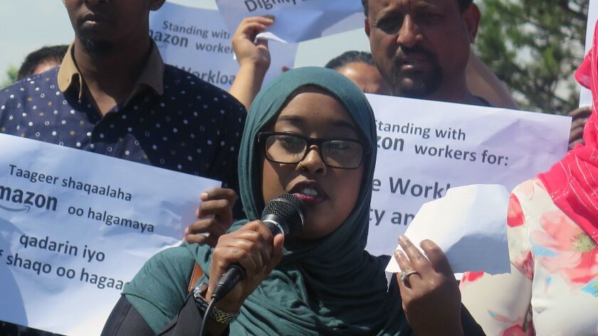 In this Monday, June 4, 2018 photo, Nimo Omar, an organizer with Awood Center, holds a press confer