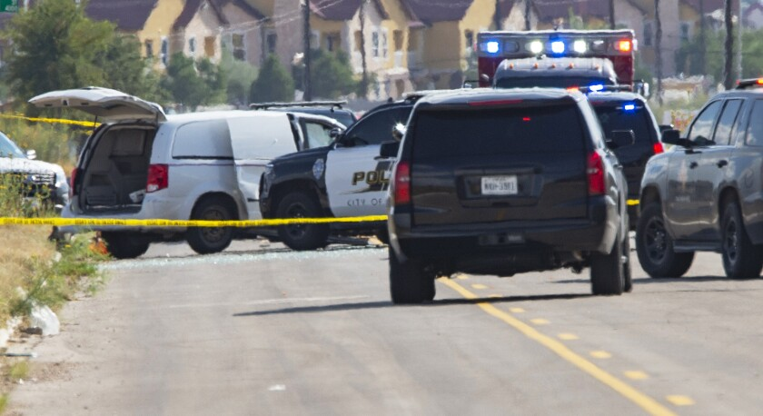 A law enforcement officer stands in the middle of the 5100 block of E. 42nd Street in Odessa, Texas, Saturday, Aug. 31, 2019, following a shooting at random in the area of Odessa and Midland. Several people were dead after a gunman who hijacked a postal service vehicle in West Texas shot more than 20 people. The gunman was killed and a few law enforcement officers were among the injured.
