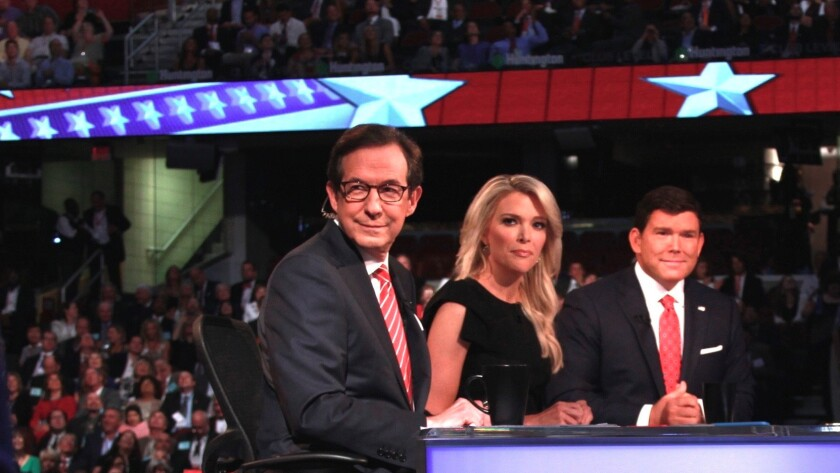 Chris Wallace, left, who will moderate the third presidential debate on Oct. 19, with Fox News colleagues Megyn Kelly and Bret Baier at the first GOP presidential primary debate in Cleveland on Aug. 6, 2015.
