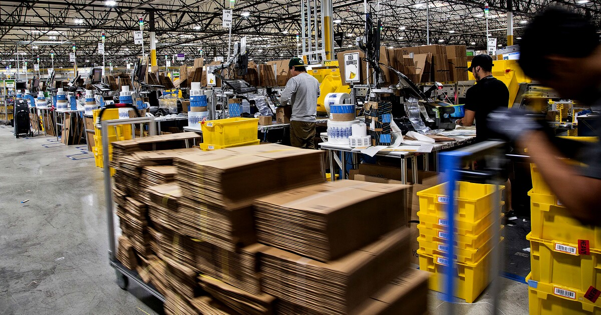 Newsom signs bill taking aim at labor practices in Amazon warehouses -