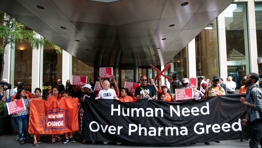 Activists rally in New York during a protest against the price of drugs.