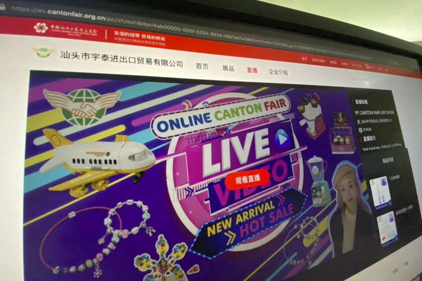 The website of the Canton Fair which delivers live streaming from vendors is seen on a computer screen in Beijing on Friday, June 19, 2020. The twice-a-year fair usually draws more than 180,000 foreign buyers and 60,000 Chinese vendors to the southern city of Guangzhou. But with most foreign visitors barred from China, the event has transformed itself into an e-commerce platform with mini-shopping channels for nearly 8,000 vendors. (AP Photo/Ng Han Guan)