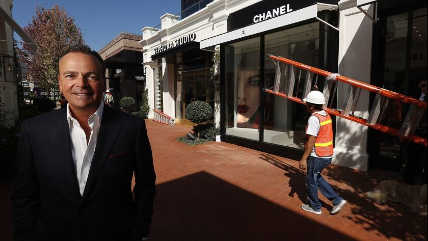 Shopping center developer Rick Caruso on the grounds of his latest project, Palisades Village in Pacific Palisades, which is opening Saturday.