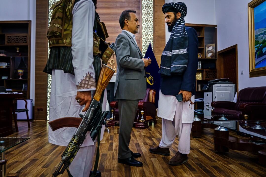 Former Kabul mayor Mohammad Daoud Sultanzoy, and new interim Kabul mayor Hamdullah Namony