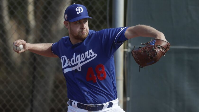 Los Angeles Dodgers' Brock Stewart throws during a spring training baseball workout Saturday, Feb. 1