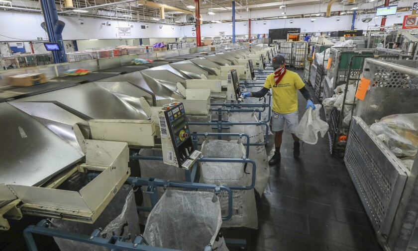Packages are sorted at a U.S. Postal Service processing and distribution center in San Diego in May.