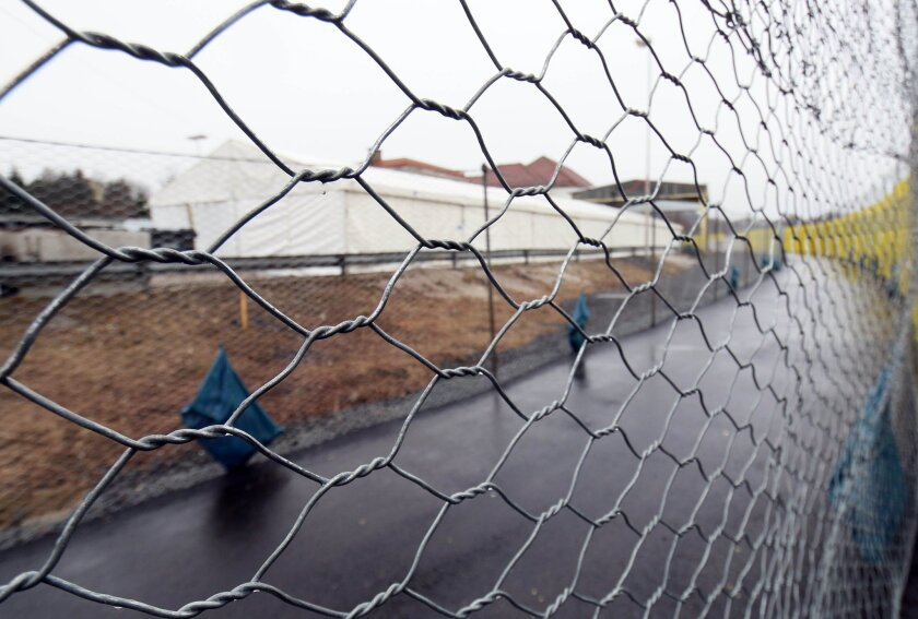 A rfegistration tent for migrants stands behind the border fence to Slovenia in Spielfeld, Austria, Friday, Feb. 19, 2016. In the latest in a series of uncoordinated and unilateral measures by nations, Austria announced that it would allow no more than 80 people a day to apply for asylum at its sou