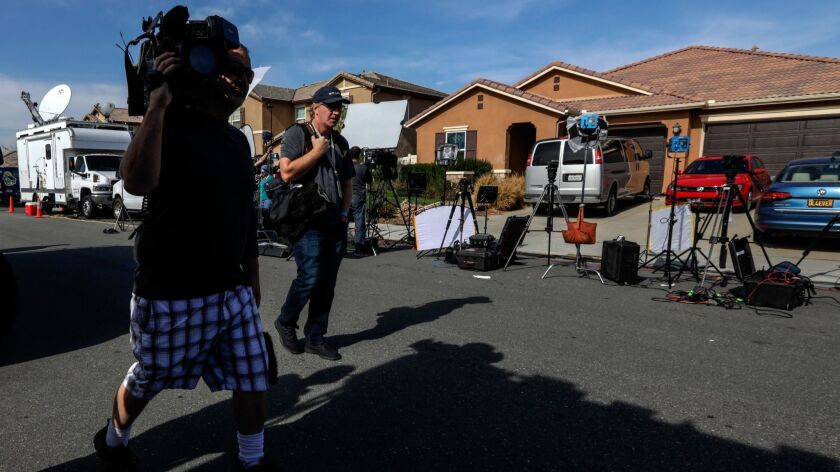 Members of the media work in front of the Perris home of David and Louise Turpin, who were arrested on suspicion of torture and child endangerment.