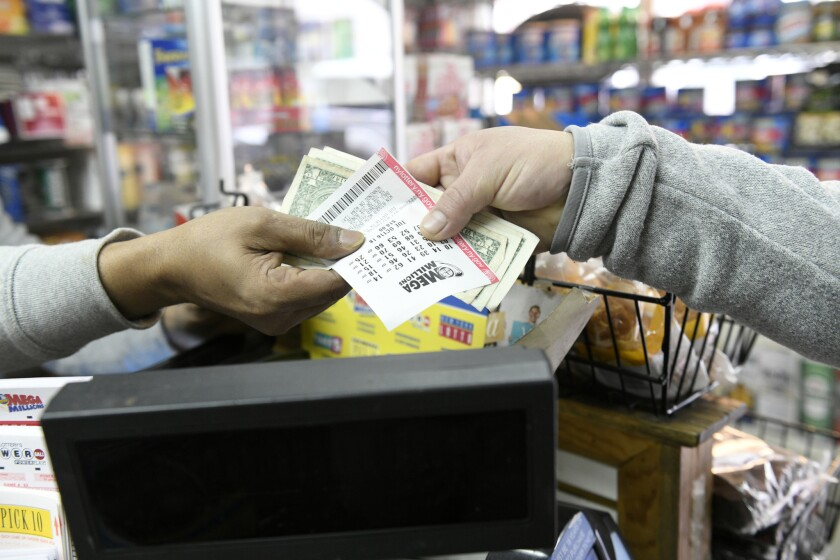 Monju Skikder sells Mega Million lottery tickets on Tuesday, Oct. 16, 2018 at Andy's Deli on West 47th St. in Manhattan, New York.