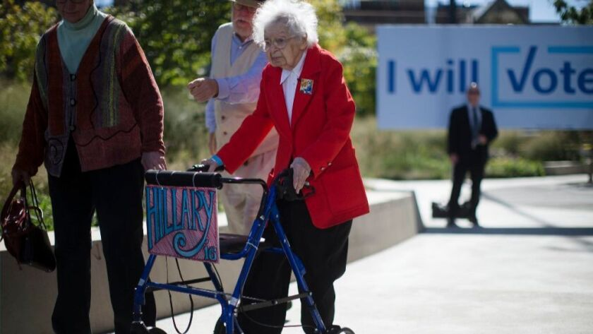Ruline Steininger, 103, arrives at a Democratic presidential candidate Hillary Clinton campaign stop in Des Moines, Thursday, Iowa, Sept. 29, 2016. She voted for Clinton in the Iowa primary.