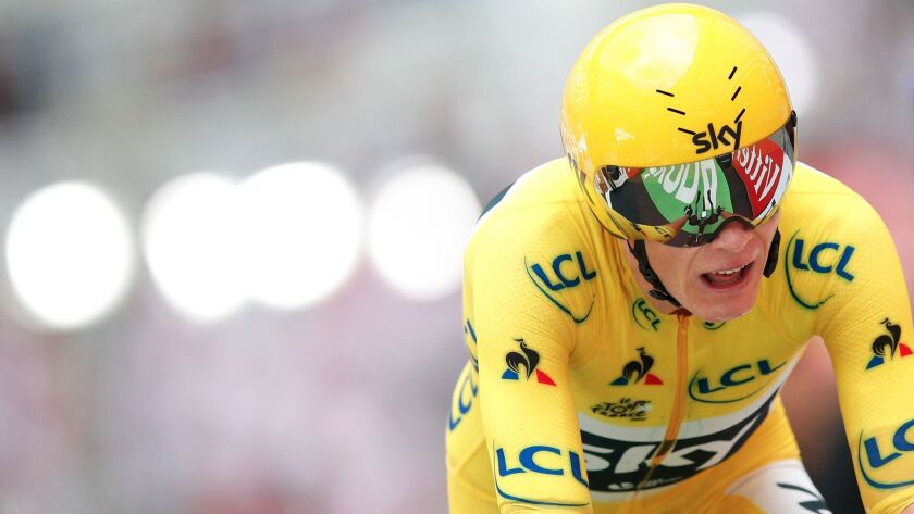 FILE - In this Saturday, July 22, 2017 file photo, Britain's Chris Froome, wearing the overall leade