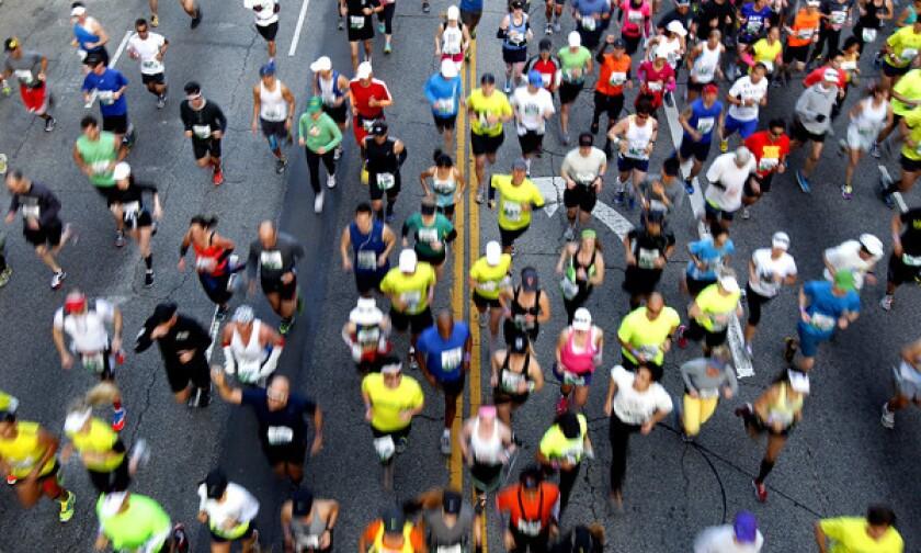 Los Angeles Marathon participants run down Cesar Chavez Avenue in downtown Los Angeles.