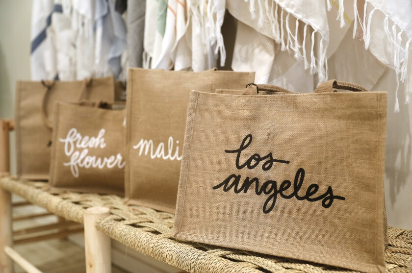 PACIFIC PALISADES-CA-SEPTEMBER 23, 2018: Reusable tote bags at The Little Market at Caruso's Palisad