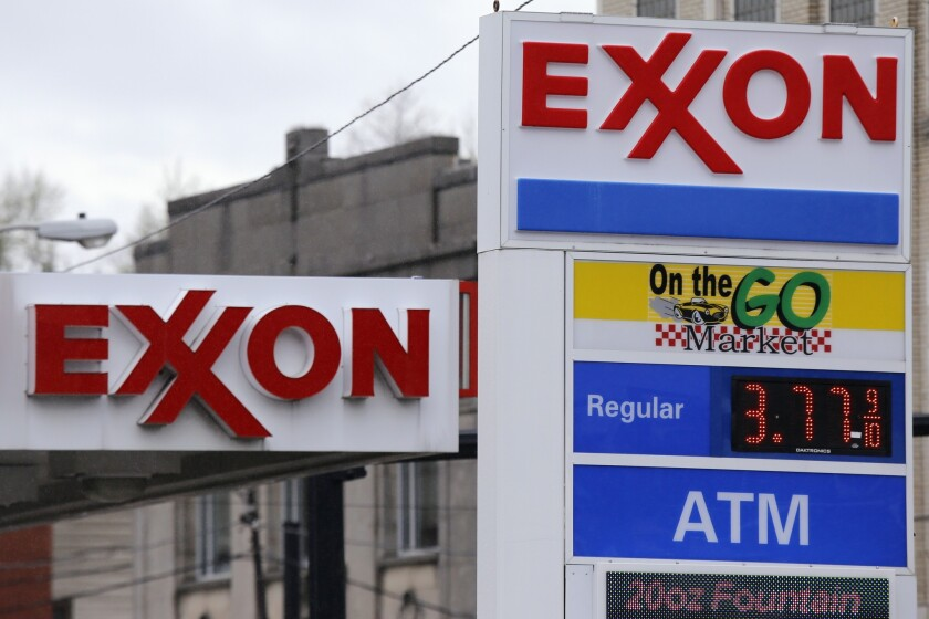Exxon signs are displayed at a Dormont, Penn. gas station.