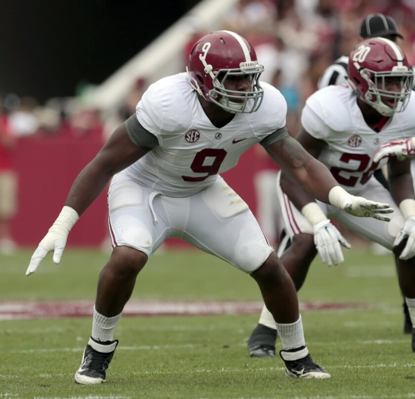 FILE - In this April 18, 2015, file photo, Alabama defensive lineman Da'Shawn Hand (9) lines up for a play during the first half of Alabama's spring NCAA college football game in Tuscaloosa, Ala. Hand knew from the first day he stepped onto Alabama's practice field that translating all that recruiting hype into Southeastern Conference success wouldn't be easy. Two years later, the player rated as the nation's top prospect by Rivals.com has a shot at continuing to carve a bigger role for the defending national champions. (AP Photo/Butch Dill, File)