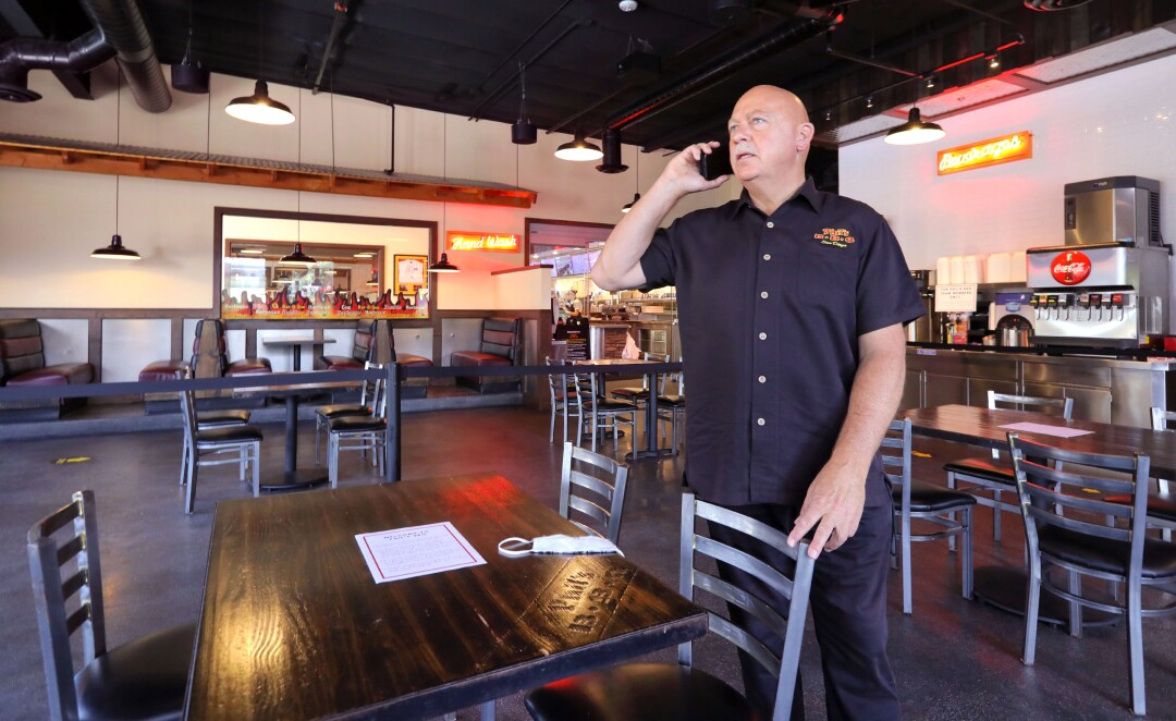 Phil's BBQ owner Phil Pace in his Rancho Bernardo location where he's reconfigured the space for dining-in under the county's new safety regulations.