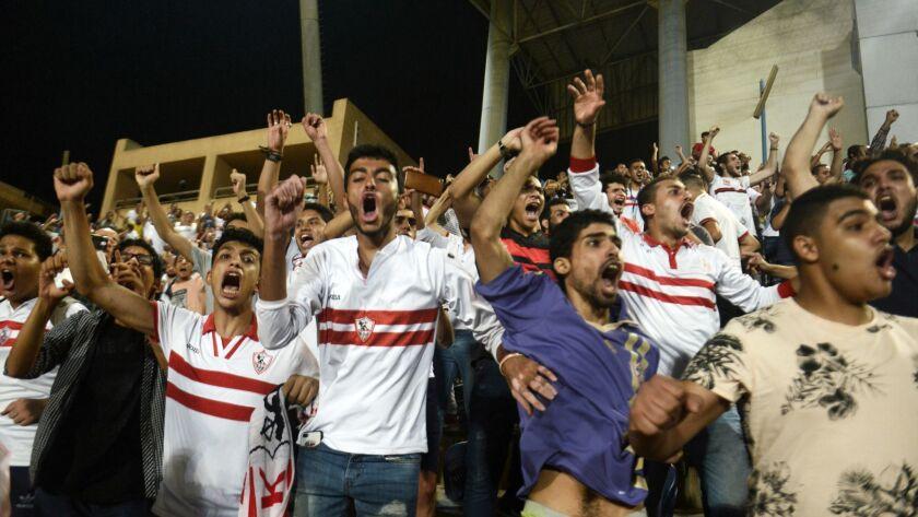Zamalek football fans cheer as their team scroes a goal during an Egyptian Premier League match betw