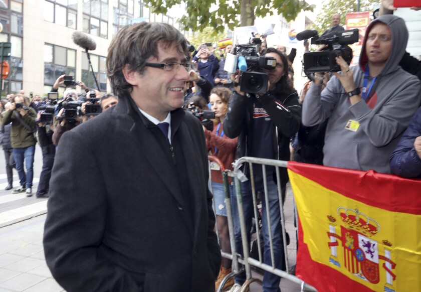 Sacked Catalonian President Carles Puigdemont arrives for a press conference in Brussels on Oct. 31, 2017.