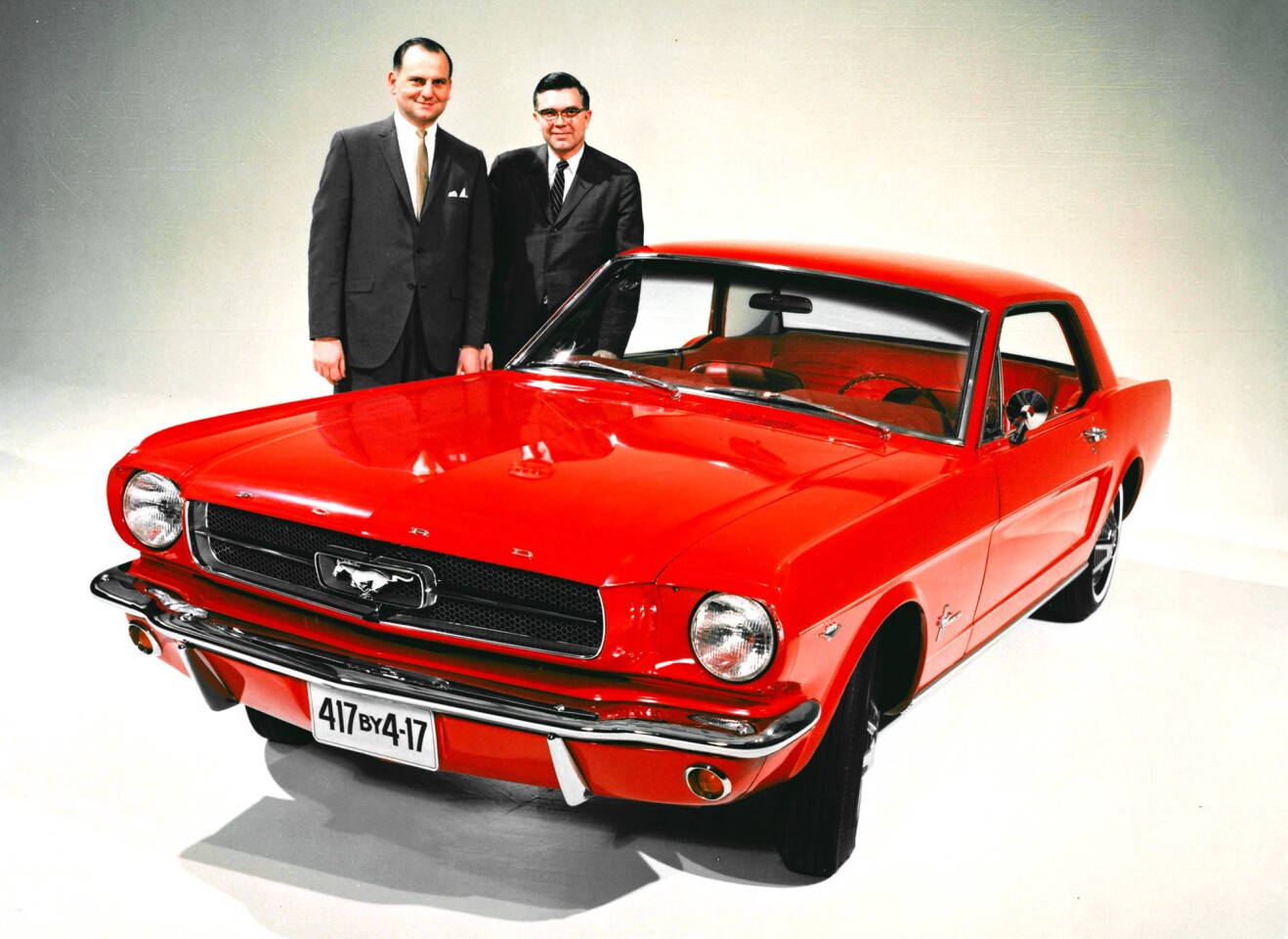 Ford Motor Co. executives Lee Iacocca and Don Frey are shown with an early Mustang. They were instrumental figures in the company's racing program of the 1960s.