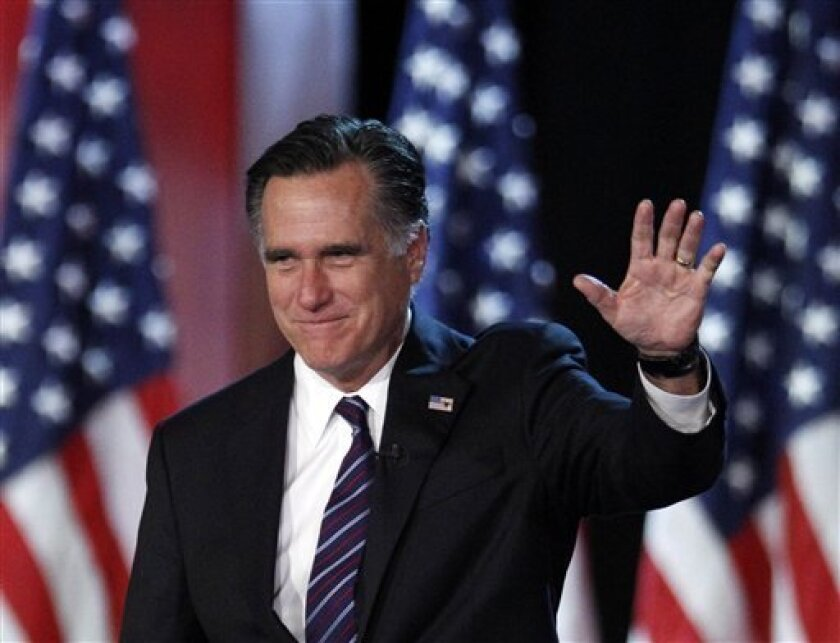 FILE - This Nov. 7, 2012 file photo shows Republican presidential candidate, former Massachusetts Gov. Mitt Romney waving to supporters at an election night rally in Boston. Romney's shadow looms over a GOP in disarray. Republican officials in Washington and elsewhere concede that Romney's immediat