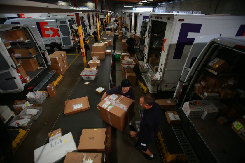 U-T File: In this Dec. 5, 2012 file photo, San Diego's FedEx central facility is a beehive of activity in the morning before trucks head out on their holiday delivery routes.