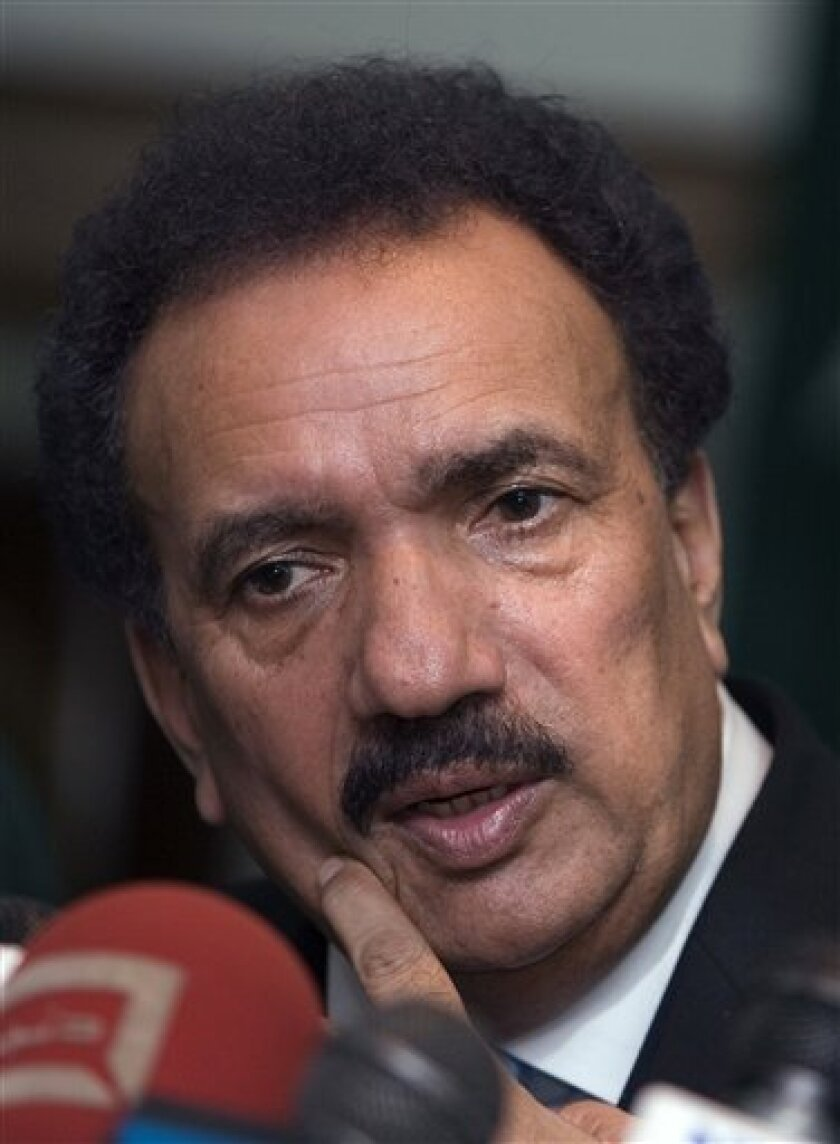 Pakistan's Interior Ministry Chief Rehman Malik gestures during a press conference in Islamabad, Pakistan on Saturday, Jan. 17, 2009. Malik said he had given investigators 10 days to complete their inquiry into the Mumbai terror attacks and investigators were looking both at information handed over