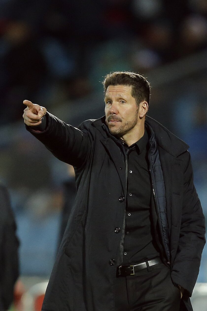 Atletico's coach Diego Simeone points during a La Liga soccer match between Atletico de Madrid and Getafe at the Coliseum Alfonso Perez stadium in Madrid, Spain, Sunday, Feb. 14, 2016. (AP Photo/Daniel Ochoa de Olza)