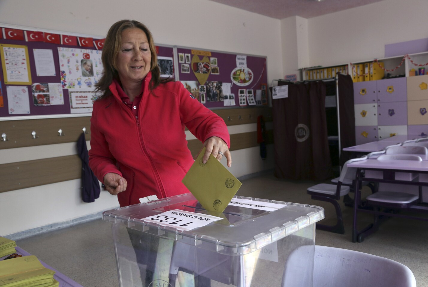A Turkish woman casts her vote at a polling station in an Ankara primary school on June 7.