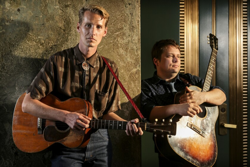 Tom Brosseau, left, and his collaborator Sean Watkins stand in the lobby of the Los Angeles Times building, Jan. 30, 2014.