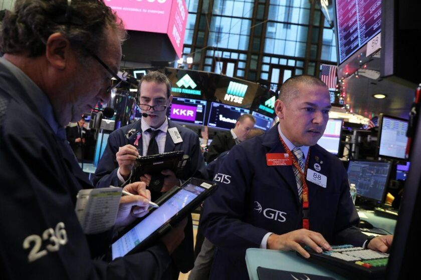 Traders on the floor of the New York Stock Exchange (NYSE). The Dow Jones industrial average fell over 600 points in morning trading as investors fears increased over a potential trade war between China and America.