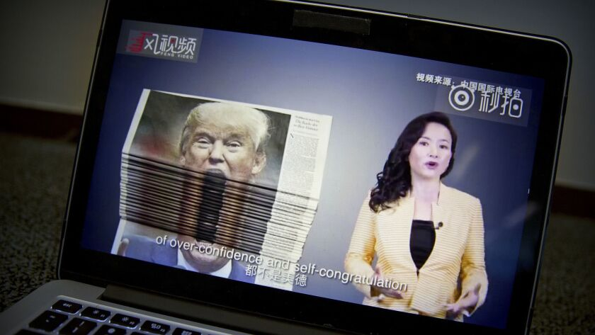 An online video about U.S.-China trade tensions produced by China's state television broadcaster plays on a computer screen in Beijing, China, on Thursday.