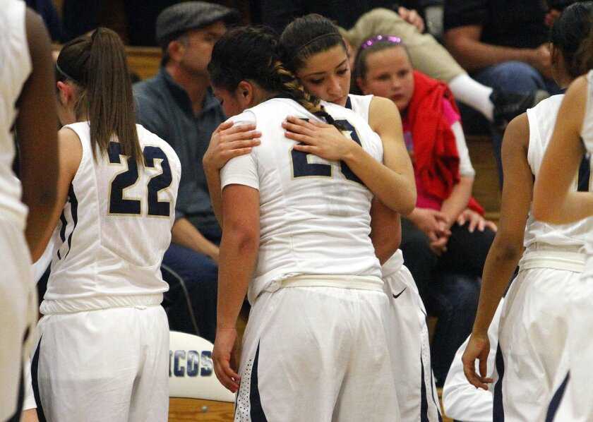 Vista Murrieta's Serafina Maulupe gets a hug from teammate Yuendie Guridi after their loss to Canyon Springs in the CIF Southern Section semifinal on Tuesday.