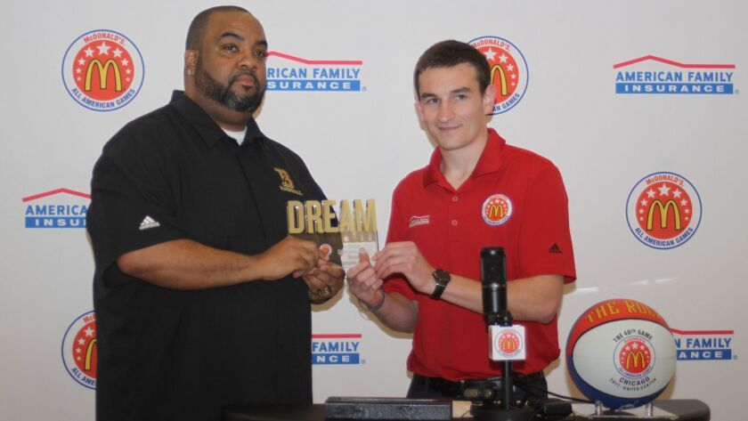 Because 'achieving dreams would not be possible without a support system,' Ryan McKay (right) presents Littleton's basketball coach Marlon Wells with the American Family Insurance Dream Champion Award.