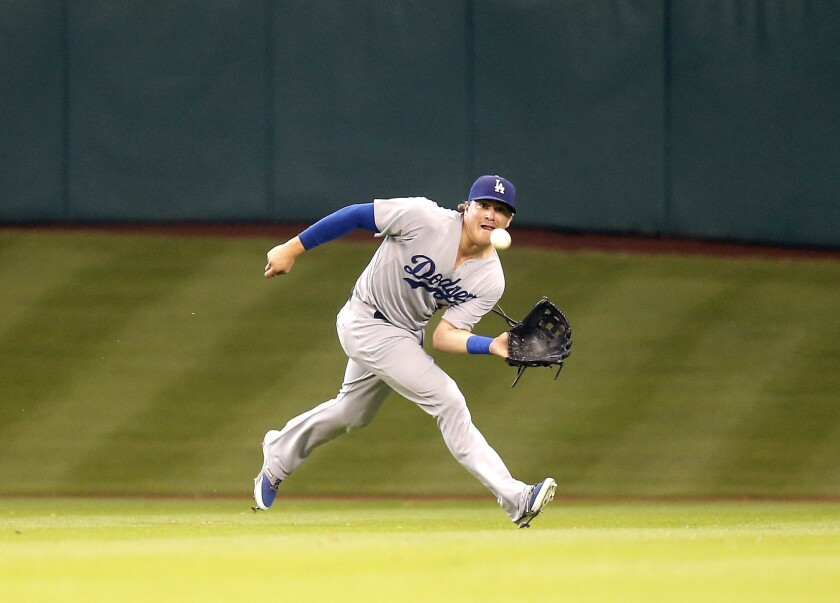 Dodgers outfielder Enrique Hernandez makes a running catch on a line drive hit by Astros second baseman Jose Altuve.