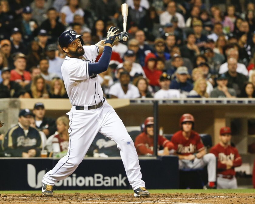 San Diego Padres' Matt Kemp watches his deep drive that was caught at the fence but drove in the Padres' Wil Myers from third with the game tying run against the Arizona Diamondbacks in the sixth inning of a baseball game Wednesday, April 15, 2015 in San Diego. (AP Photo/Lenny Ignelzi)
