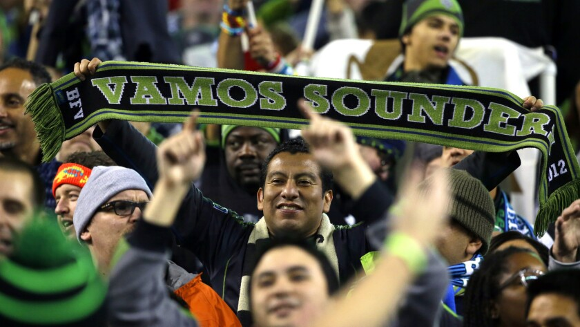 Seattle Sounders fans celebrate after the team's playoff series victory over FC Dallas on Nov. 10.