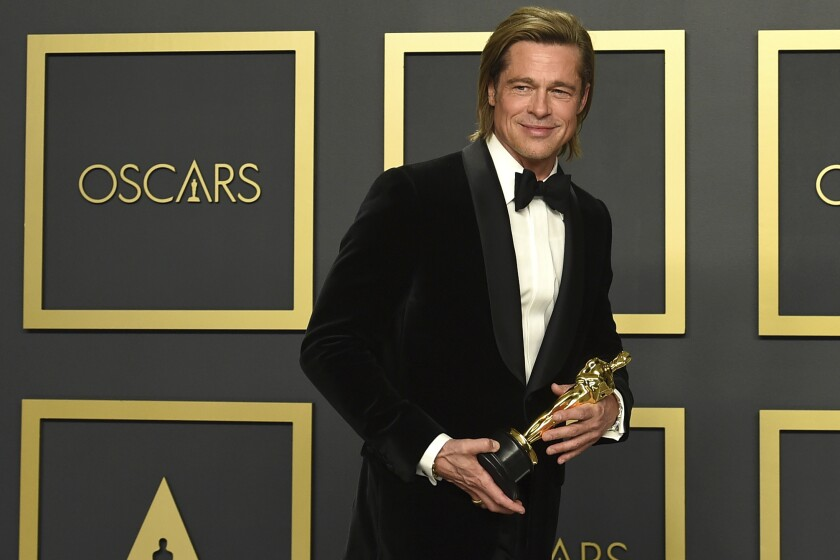 """Brad Pitt, winner of the award for best performance by an actor in a supporting role for """"Once Upon a Time in Hollywood"""", poses in the press room at the Oscars on Sunday, Feb. 9, 2020, at the Dolby Theatre in Los Angeles. (Photo by Jordan Strauss/Invision/AP)"""