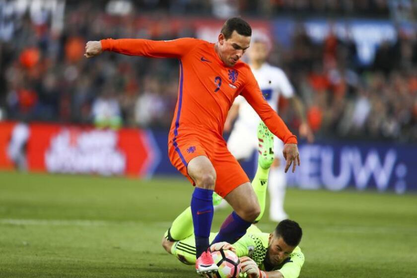 Dutch Vincent Janssen (C) vies for the ball with goalkeeper Ralph Schon of Luxembourg during the FIFA World Cup qualifier soccer match between the Netherlands and Luxembourg in Rotterdam, the Netherlands. EFE/EPA/Jerry Lampen/File