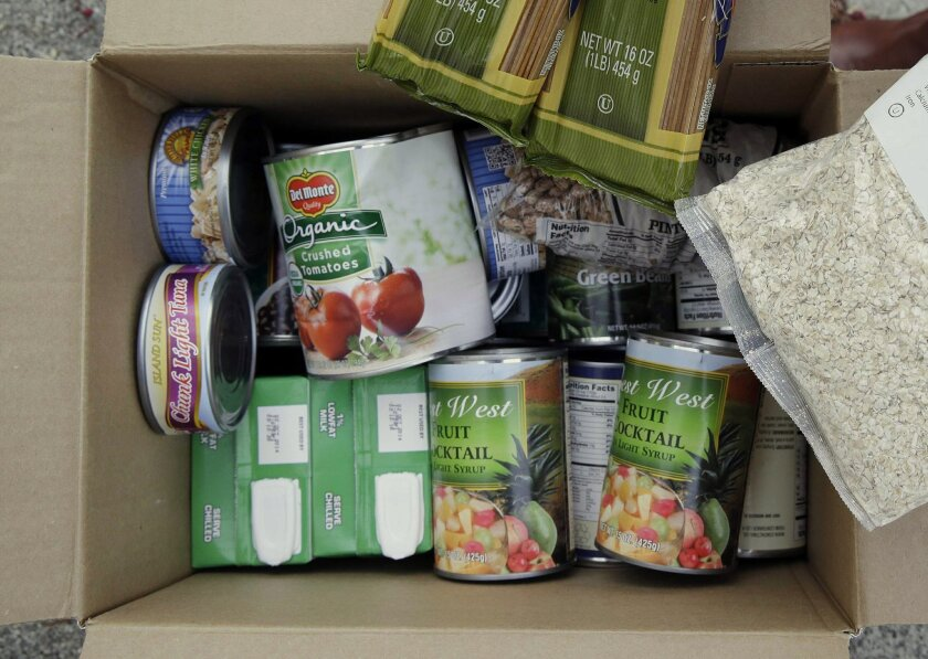 In this Jan. 8, 2014, shows the contents of a specially prepared box of food at a food bank distribution in Petaluma, Calif.